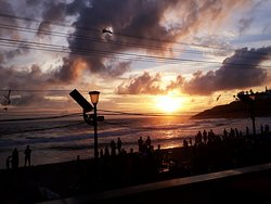 Kovalam beach- Sunset. Sea is not calm enough for you to walk in. There are enough cafe's around to sit and watch the sunset and enjoy lemon soda with some great live seafood stall.