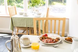 Breakfast is served in the bright conservatory