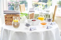 In addition to a choice of cereals, fresh fruit, homemade yoghurt and juice a cooked breakfast is available from the menu