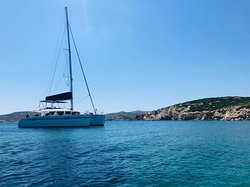 Picture I took of our boat, Poker Face in a bay near Syros from one of the SUP. Look at that beauty!