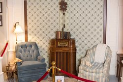 A diorama of a 1950's living room where the radio was the center of attention.