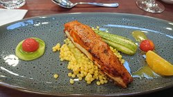 2nd course- Barramundi, sundried tomato crust, basil coulis, concussee, orange cous cous, white zucchini, citrus reduction.