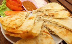 Quesadillas - Grilled flour tortilla with cheese,served with salsa and cream sauce.