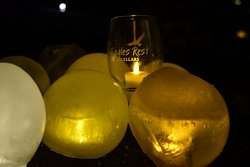Enjoying a little sip while lighting the vineyard.