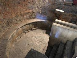 Semi circular bath probably used for treatments.