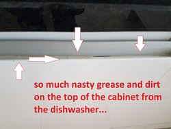 Grease on the ridge where you have to pull the cabinet open to open the dishwasher