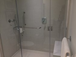 Wonderful spacious shower, great amenities, clean. In shower seat/bench.