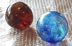 glass paperweight brown or ruby red depending on lighting and sapphire blue blown glass ornament