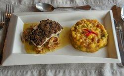"""""""Hubo Pilcan""""  Pesca del día con costra de harina tostada y luche, acompañado de charquicán de cochayuyo, con salsa de navajuelas y ajos chilotes."""
