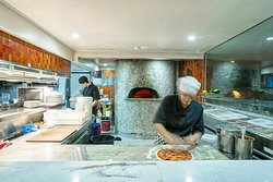 The pizzas from the wood fired oven are mouth watering