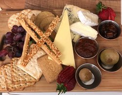 sharing cheese board comes with two small glasses of wine red or white at CafeBar21