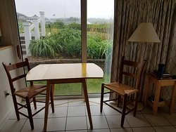 Other sliding glass doors near dinette table and chairs.