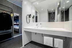 Open and spacious bathroom in clean Scandinavian design