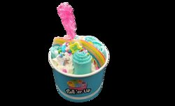 Cotton candy base, with sprinkles incorporated into the ice cream, topped with lucky charms, rainbow belt, lollipop of the day