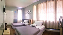 SESSION ROOM - Two double beds, Private Toilet (Hot and Cold Shower) , Cable T.V , Electric Fan, Free Wifi