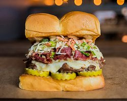 THE MENSCH – white american cheese, pickles, pastrami, haus slaw, secret sauce