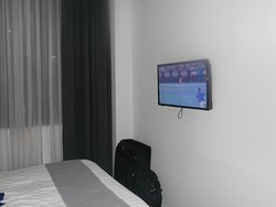 Room showing flat screen tv with Australian Open on