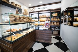 Our beautiful girl Maria at Thiseus Bakery will service you with our best products