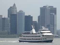 The cruise boat with a well known Manhattan backdrop.