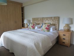 Garden Room. Super king-sized bed with large en-suite shower room. Access to the Walled Garden