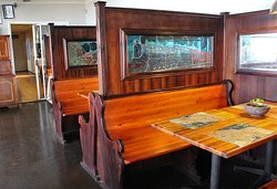 The dining area in an authentic railway dining car.