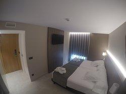 Habitación superior dos camas.
