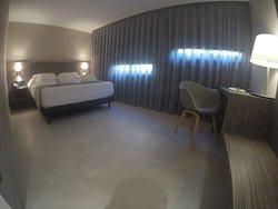 Habitación superior cama de matrimonio.