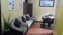 Living room and dinning room of DeLuxe Family Suites