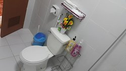 A Private Toilet and shower DeLuxe Family Suites with Shampoo,Body wash Liquid,Hand soap,face towel,hand towel and tissue paper.