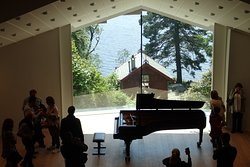 The modern concert hall looks out to the composer's hut and the lake