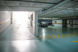 Our private garage where you can park your car (additional cost). It has direct access to the apartments by elevator.