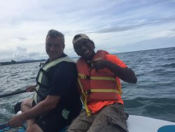 Captain Larry and Dennis rescuing us when our Hobie went astray.