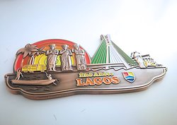 Lagos Themed Fridge Magnet. This colourful fridge magnet offered by GEMS store captures the spirit of Lagos beautifully. Made or antique copper, it feels solid and expensive.  www.yourgemstore.com