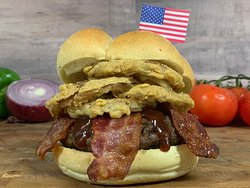 BP Big Mouth Burger. 8 oz. patty stuffed with cheddar cheese, topped with bacon, fried onion rings and BBQ sauce.