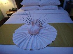 Towel art kept on Bed