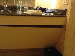 Falling panel under bathroom sink