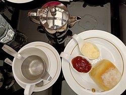 Scones, jam and cream with tea