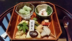 Hassun (24 cm 2 tray): Oba Sorbet, Octopus & Pea bean sprout with sesame dressing, Smoked tomato marinated with miso and tofu on top, Squid tentacles marinated in a spicy sauce,  Marinated Onion, Potato with miso sauce, Okra with sour plum meat, June eggplant, Hamo roe in scrambled egg