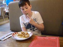 Boy enjoying his dinner.