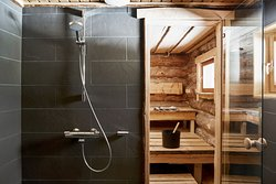 Villa Anna´s bathroom and log sauna with a view to the lake. We at Hawkhill combine traditional Finnish craftsmanship with modern ameneties and luxury.