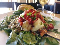 Our Berry & Brie Chicken Dinner. A succulent grilled chicken breast covered in a balsamic glaze, topped with brie cheese and fresh berries served over rice and spinach!