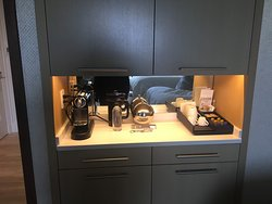 Coffee area in the room. Had a Nespresso, and the cabinet above opened into a mini fridge.
