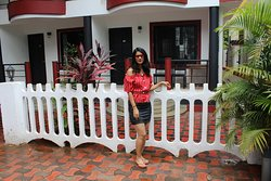 Nitu standing in front of Henmill Holiday Homes...