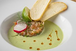 80g SALMON TARTAR WITH SHALLOT, served in cold cucumber soup with dill and chilli oil, baguette chips