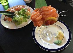 Some extra-special presentations! - special roll & salmon sashimi.