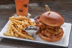 Buttermilk Fried Chicken Sandwich with Salt & Pepper Honey Chicken breast marinated in our house buttermilk blend then breaded and fried. Caramelized pineapple slices inside the sandwich. Drizzled with salt & pepper honey and served on a brioche bun.