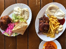 The half chicken with fries and the half chicken with salad.  With hummus, garlic sauce and hot sauce of course.