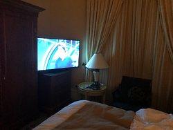 TV crammed in corner of room.
