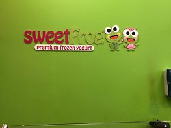 Sweet Frog - sign on wall