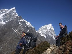 Porters and trekkers having rest on the way to Everest